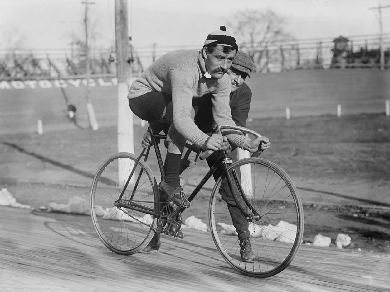 Leon Gorget on bicycle, 1909