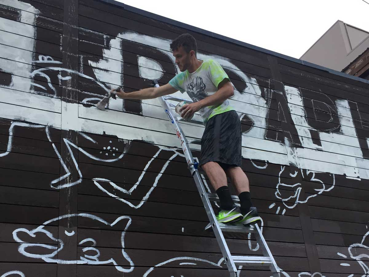 Keep Cap Hill Queered Mural process: Evann painting close